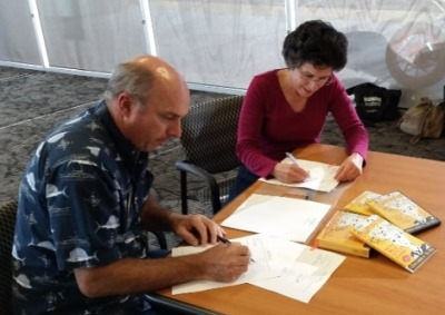 Eric Riddle and Brenda Avadian sign their post nup agreement