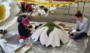 Affixing coconut flakes Rose Bowl Parade Float